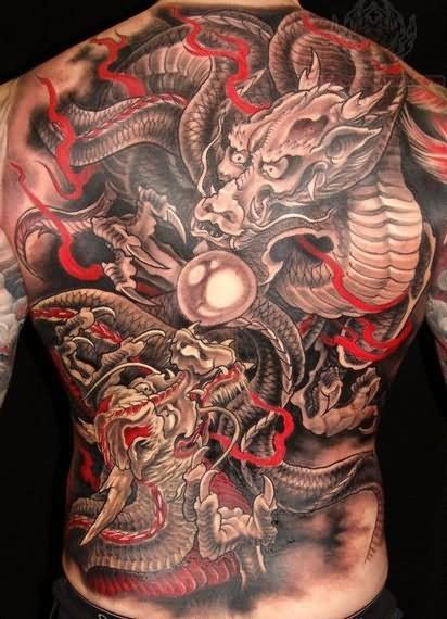 Two dragons tattoo on whole back for men