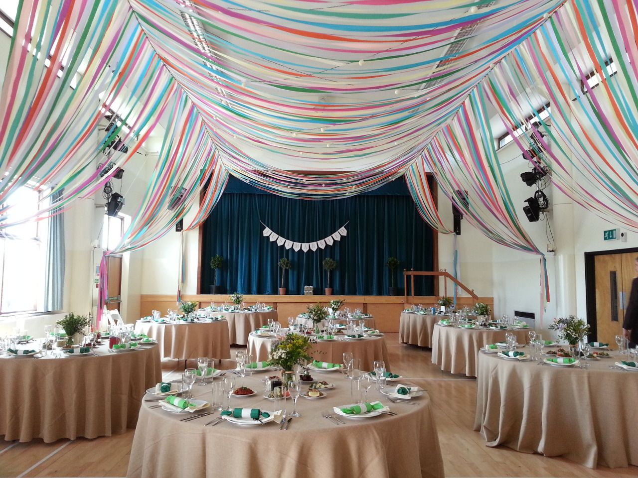 Colourful-ribbon-canopy-wedding-reception-town-village