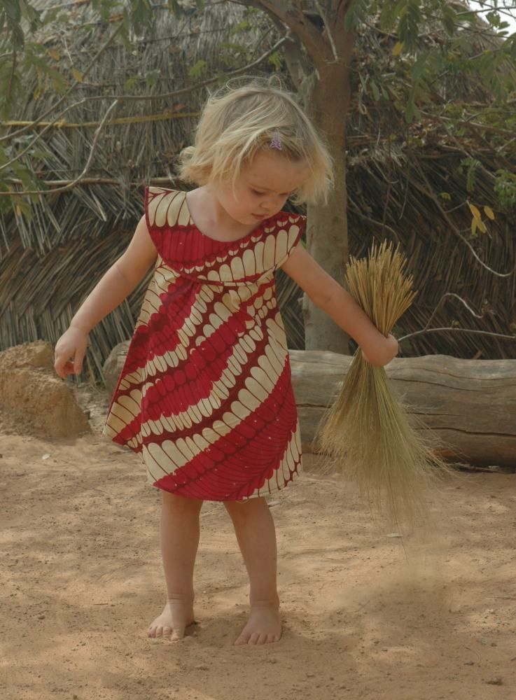 My little girl having fun sweeping the yard..and modelling at the same time! http://goo.gl/dG714