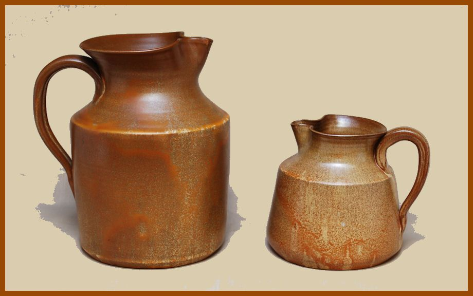 Two pitchers from J. B. Cole pottery showing the brown-over-white glaze.