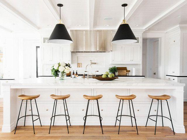 Modern All White Kitchen With Large Black Pendant Lights A White Marble Island And Woode Modern Farmhouse Kitchens Home Decor Kitchen Interior Design Kitchen