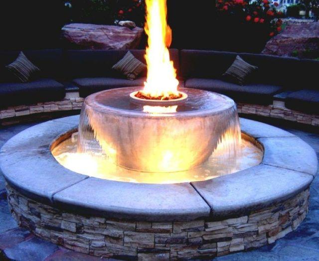 Fuente redonda pozo fuego casa nueva sala de tele for Diseno de fuente de jardin al aire libre