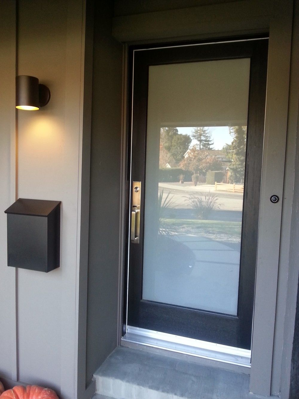 New laminated glass panel front door with lovely hardware for Glass door in front of front door