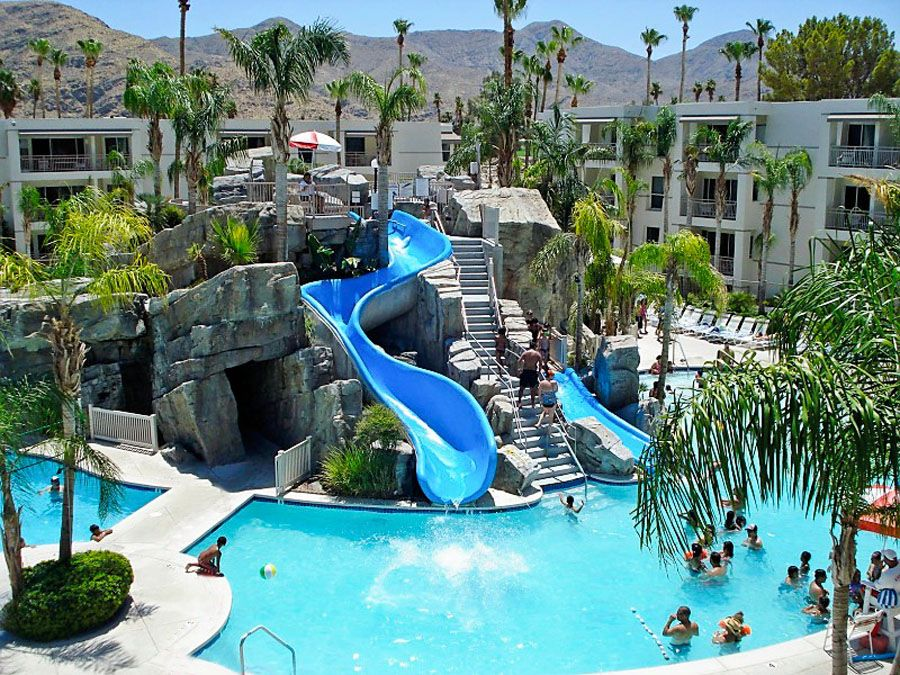 Family Pool With Waterslides At The Palm Canyon Resort In