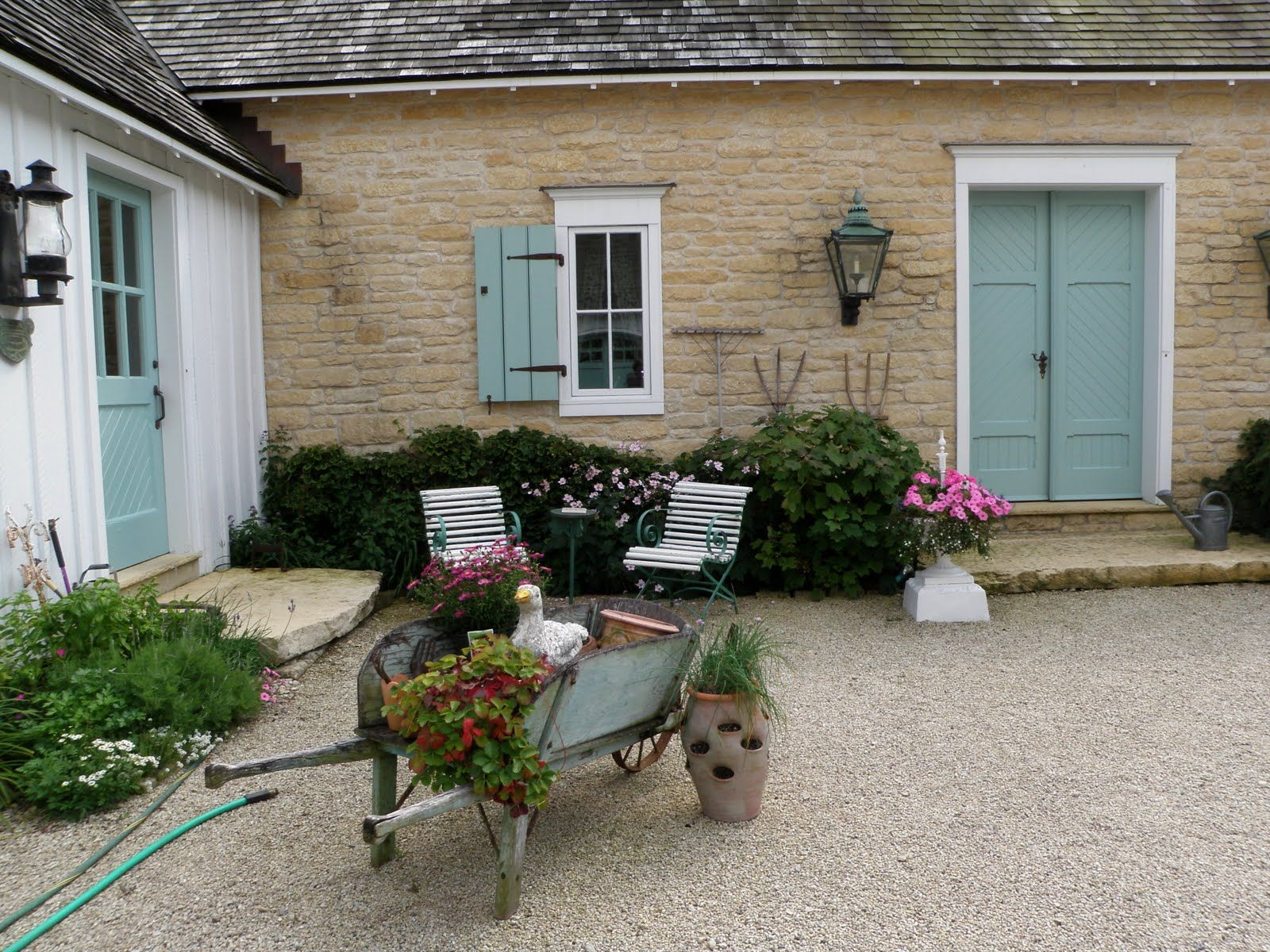 courtyard with wheelbarrow | French country farmhouse, Country ...