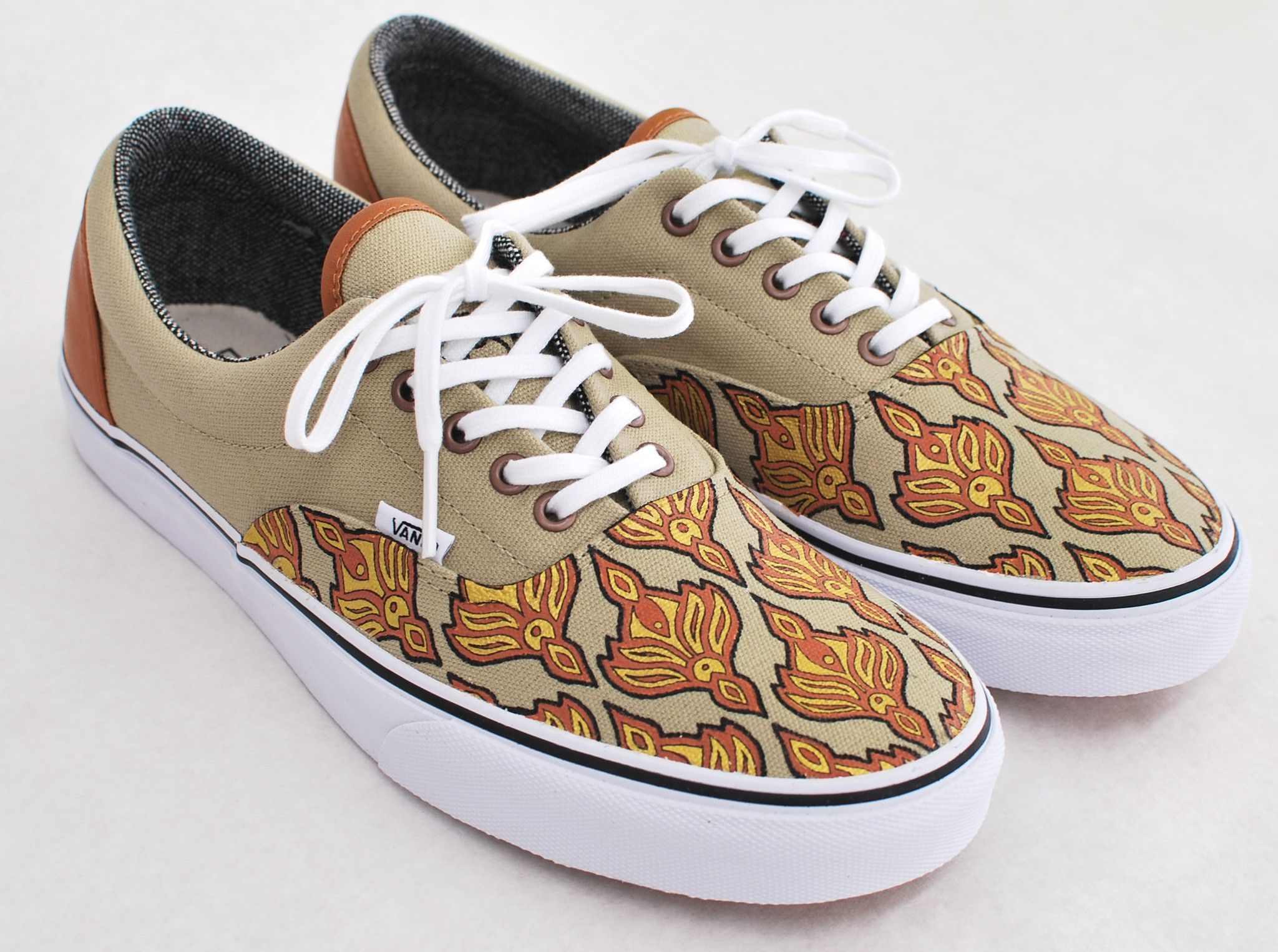 e7d972b47c These custom light khaki  tweed C L Era Vans are hand-painted with an  ornaments texture. A Brown