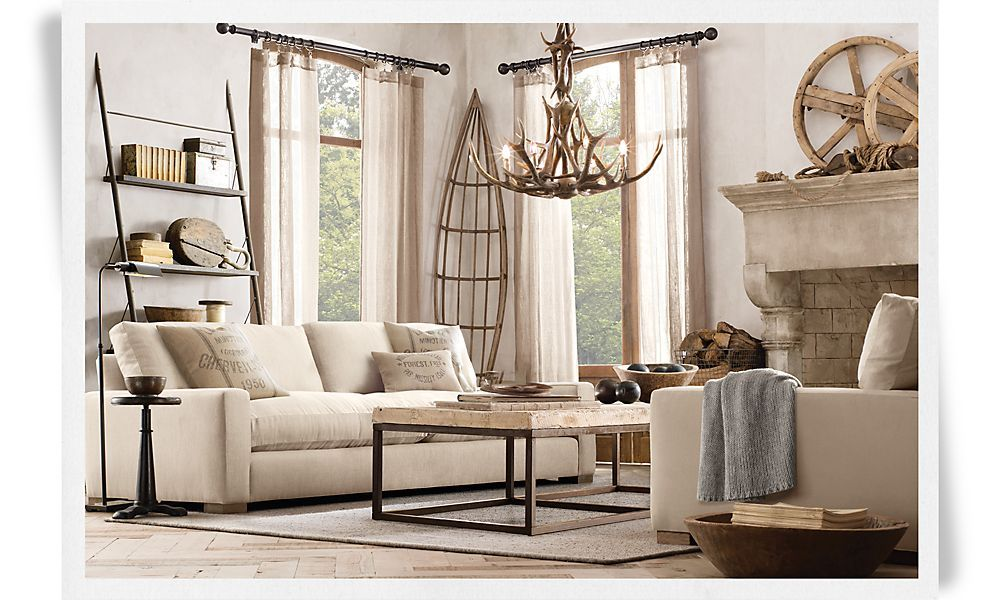 an antler chandelier from restoration hardware helps define the rustic look of this as lake homes are called in many parts of lake