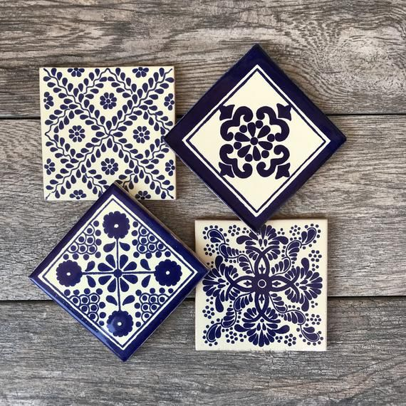 Mexican tiles have been lovingly turned into beautiful coasters for your home! These are authentic tiles made in Mexico. The addition of a cork pad on the bottom make them scratch-proof for your table tops or other surfaces. They are each 4