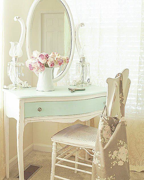 white and aqua dressing table with oval mirror