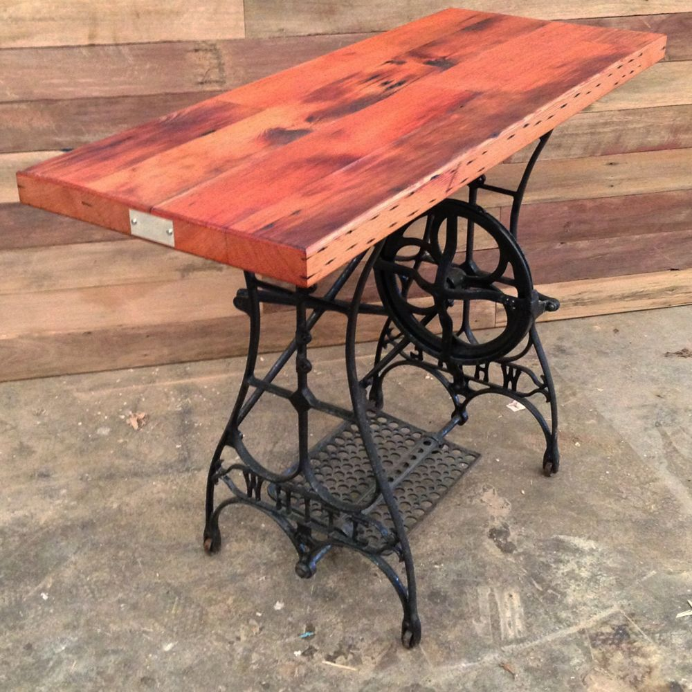 classic use of an industrial piece beautiful antique sewing machine table with a wood top. Black Bedroom Furniture Sets. Home Design Ideas