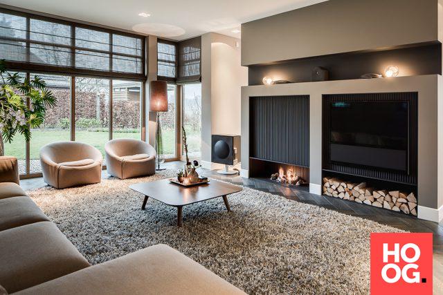 Woonkamer inrichting met luxe open haard | woonkamer ideeën ...
