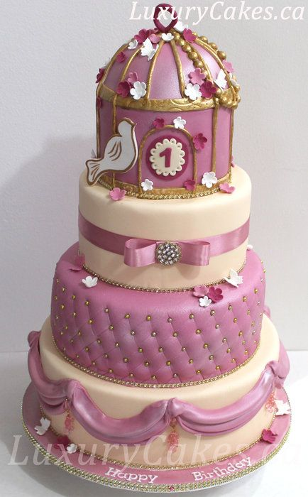 Birdcage cake with ivory, dusty rose, gold and white colors.