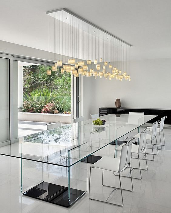 transparent glass table with glass legs and black bases