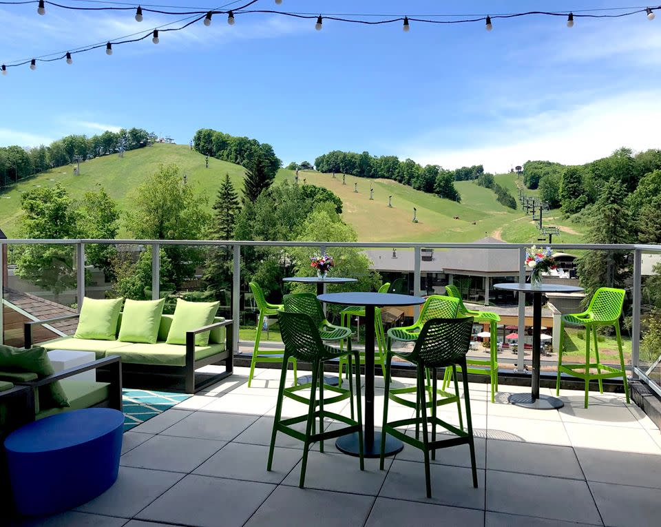 Level Four Rooftop Bar Is Taking Cocktails And Entertainment To An Entirely New Level Atop The Inn At The Mountain Level Four Is In 2020 Rooftop Bar Rooftop Outdoor