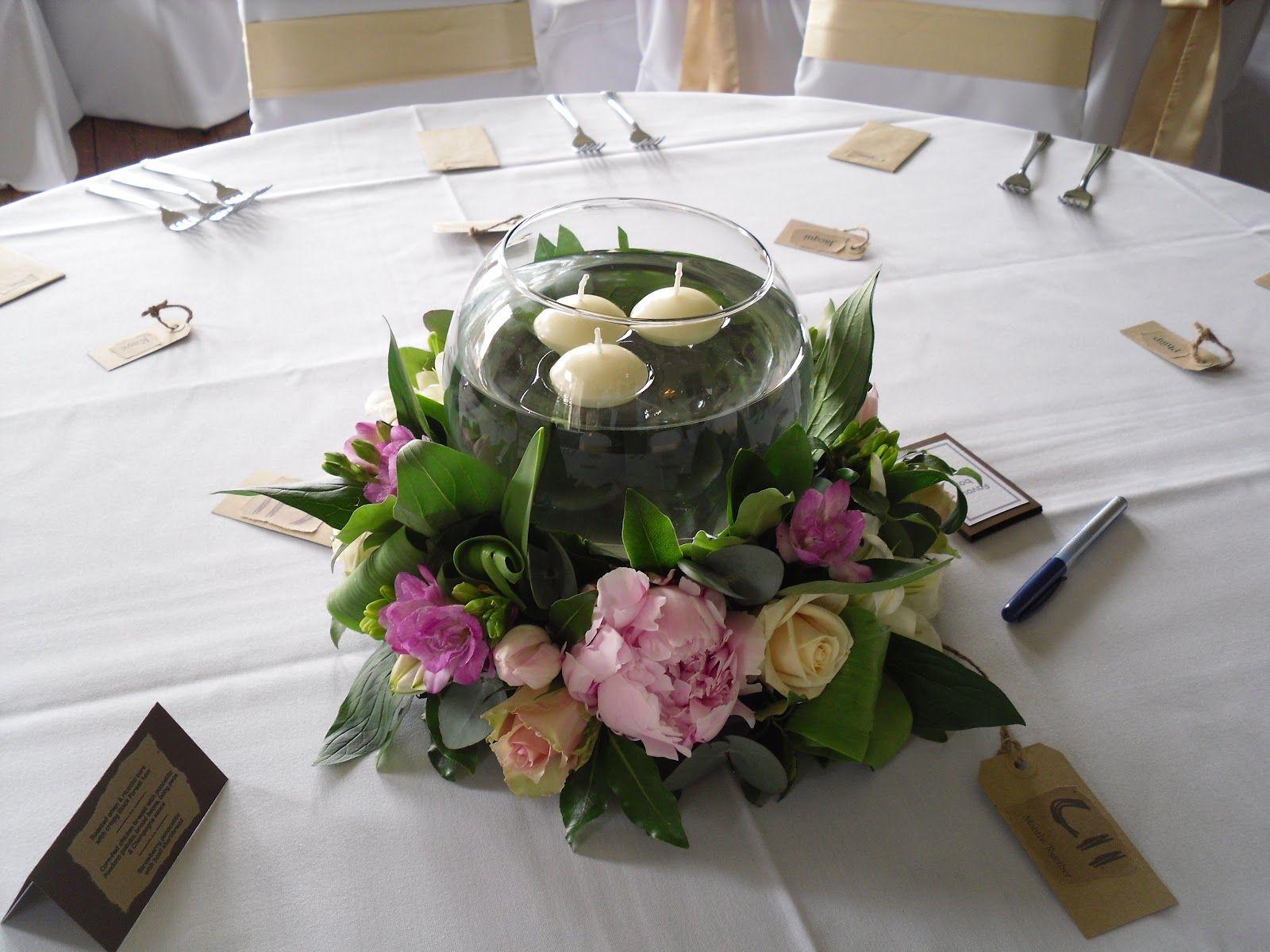 The table centres were a round arrangement of pink Sarah Bernhard