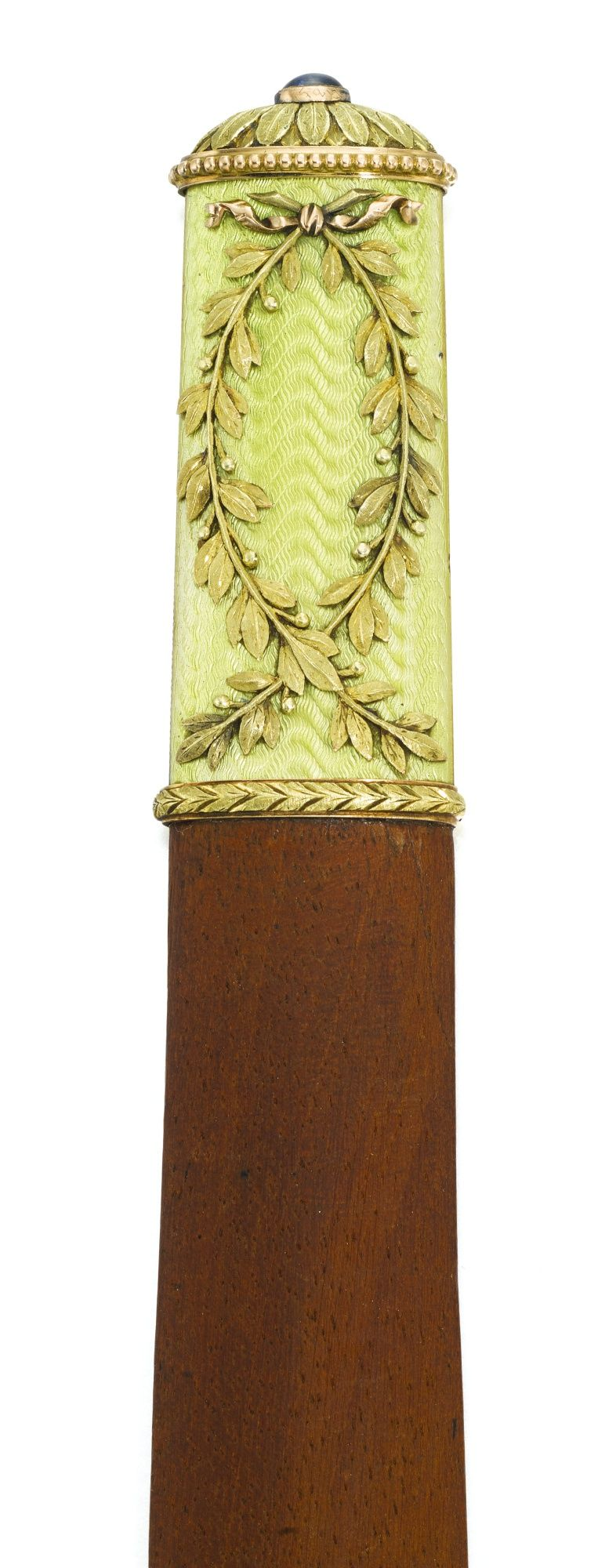 A Fabergé gold-mounted enamel and wood paper knife, workmaster Feodor Afanassiev, St Petersburg, 1904-1908 the handle of translucent apple green enamel over wavy engine-turning and applied with ribbon-tied laurel, the rosette terminal set with a cabochon sapphire, palisander blade, struck with workmaster's initials, 56 and 88 standards, scratched inventory number 15862