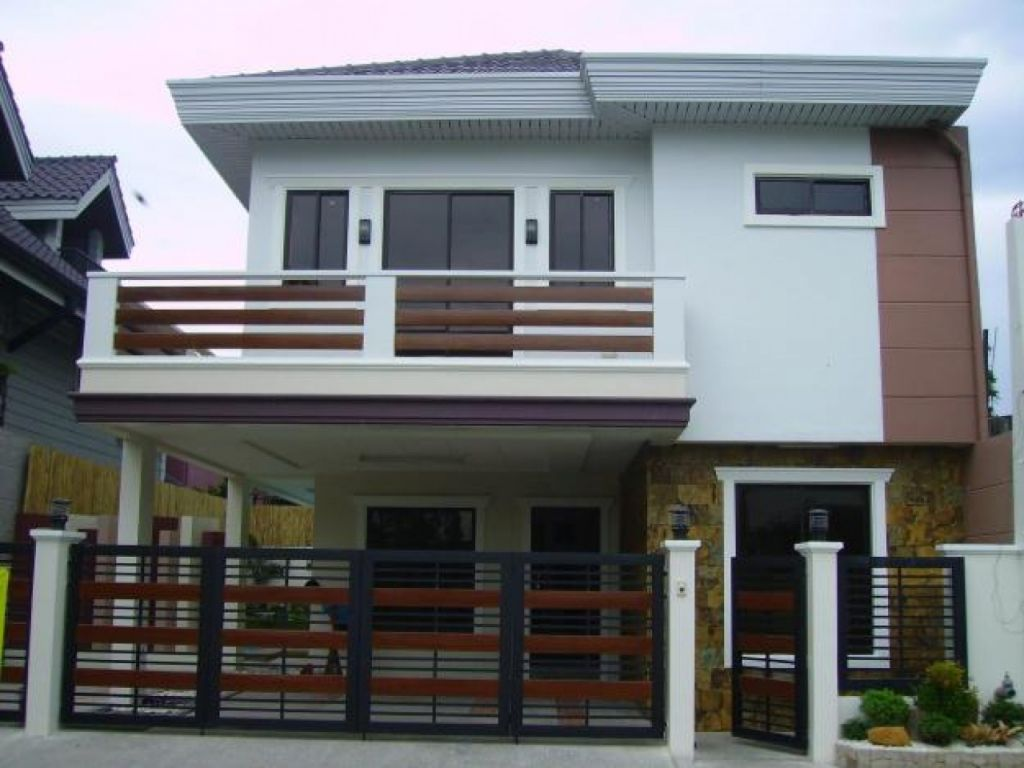 Design 2 storey house with balcony images 2 story modern for Modern house grill design