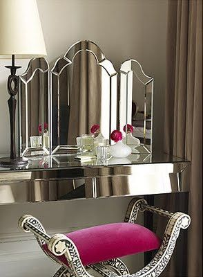 This silver art deco vanity rests on black legs & has a triple pane mirror. Just pull up the elegant stool with a rose colored cushion & begin your makeup ritual. Very posh.....V