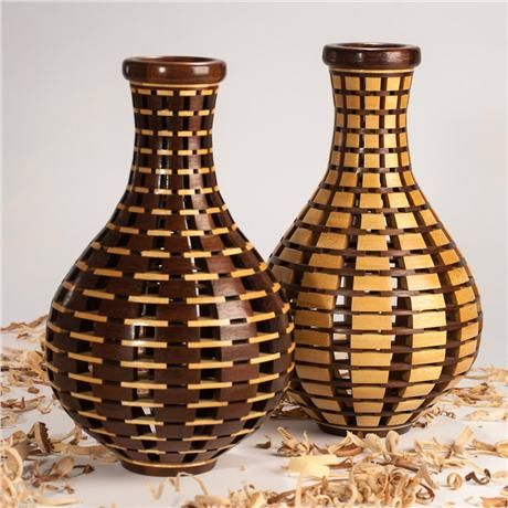 """Pair of turned open segmented vessels made from peruvian walnut and yellow heart woods. Around 11"""" tall by 6 3/4""""."""