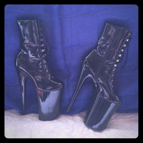 One pair of 9 inch pleaser heels. Worn