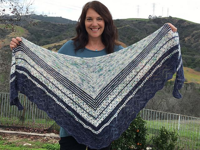 An elongated triangular shawl with lots of texture, eyelets, stripes and a simple lace border, using your favorite speckled yarn along with a contrasting color, you'll create a shawl that embraces your inner diva.