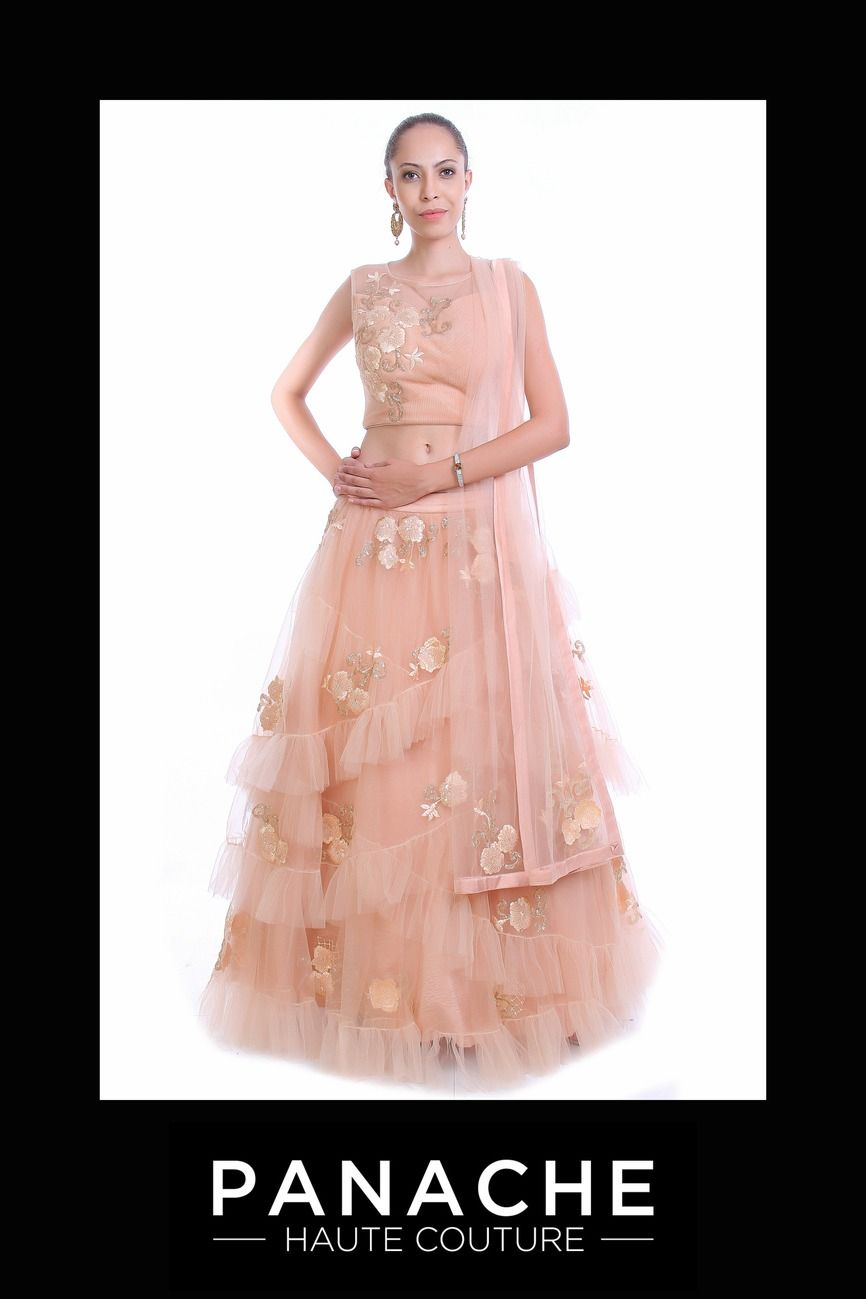 f3d90a5c2f This lehenga choli is featured in the peach colour net fabric. The skirt of  this