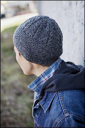 0e9a2dd2339 This hat features a deep garter stitch brim and a crown of slipped stitch  horseshoe cables. The grey version shown here in the colorway Soot includes  ...