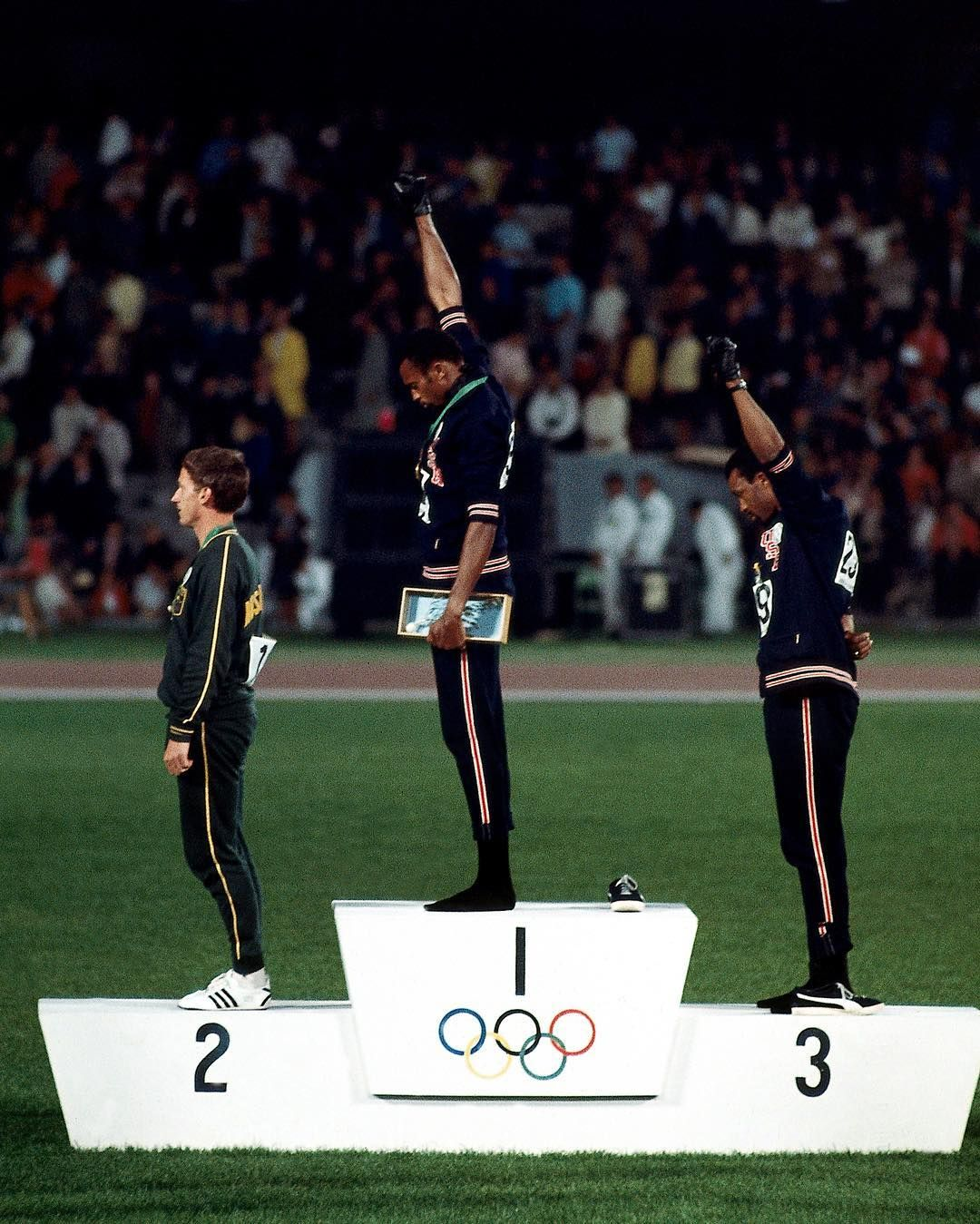 Australia Peter Norman (silver), USA Tommie Smith (gold