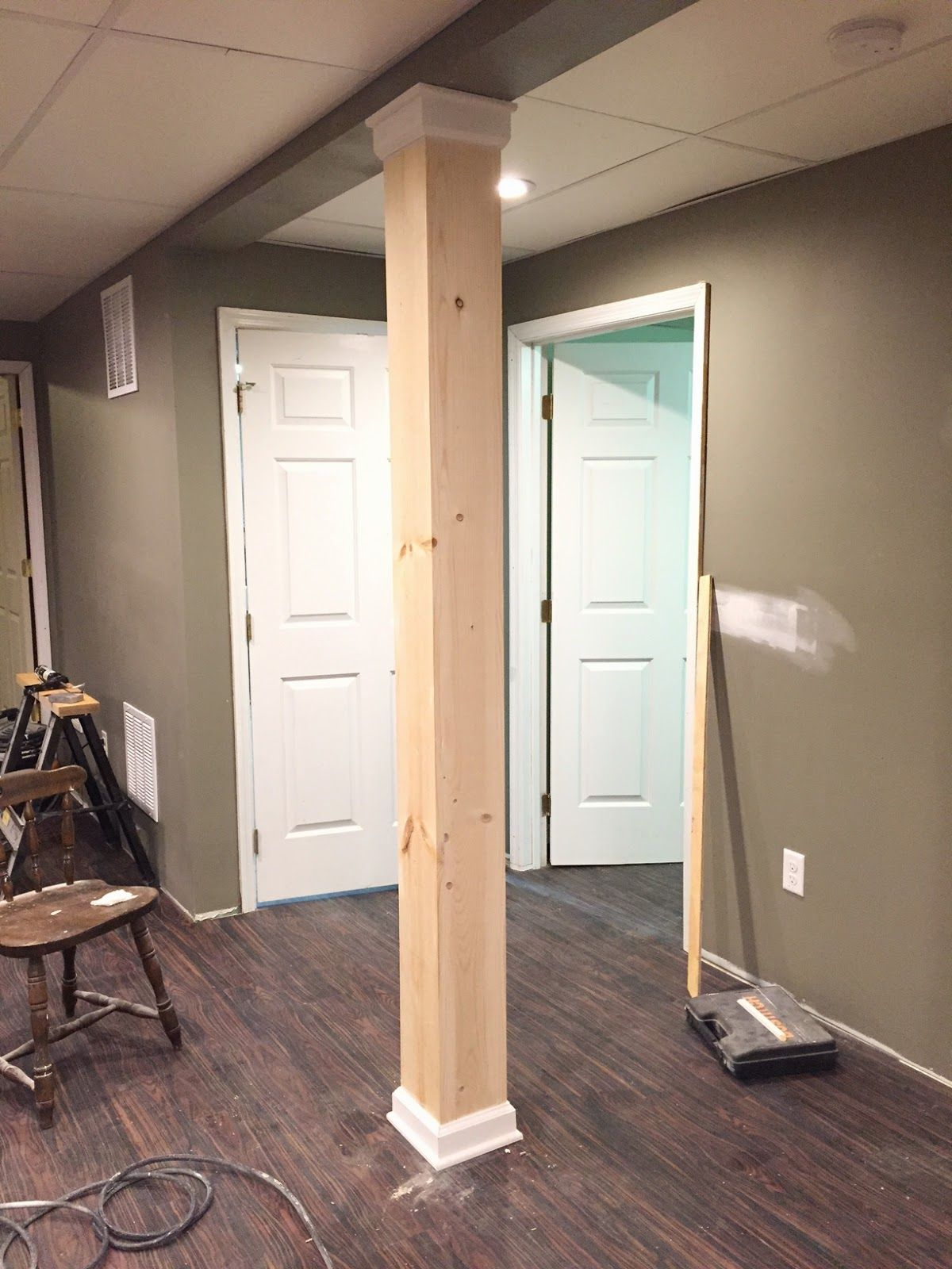 Over on dover a post about a post disguising a basement for Garage column wrap