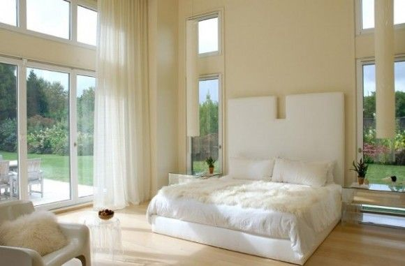 White bedroom with high ceiling