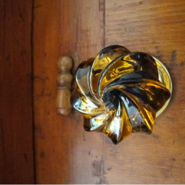 amber whirl glass door knob by merlin glass so pretty home