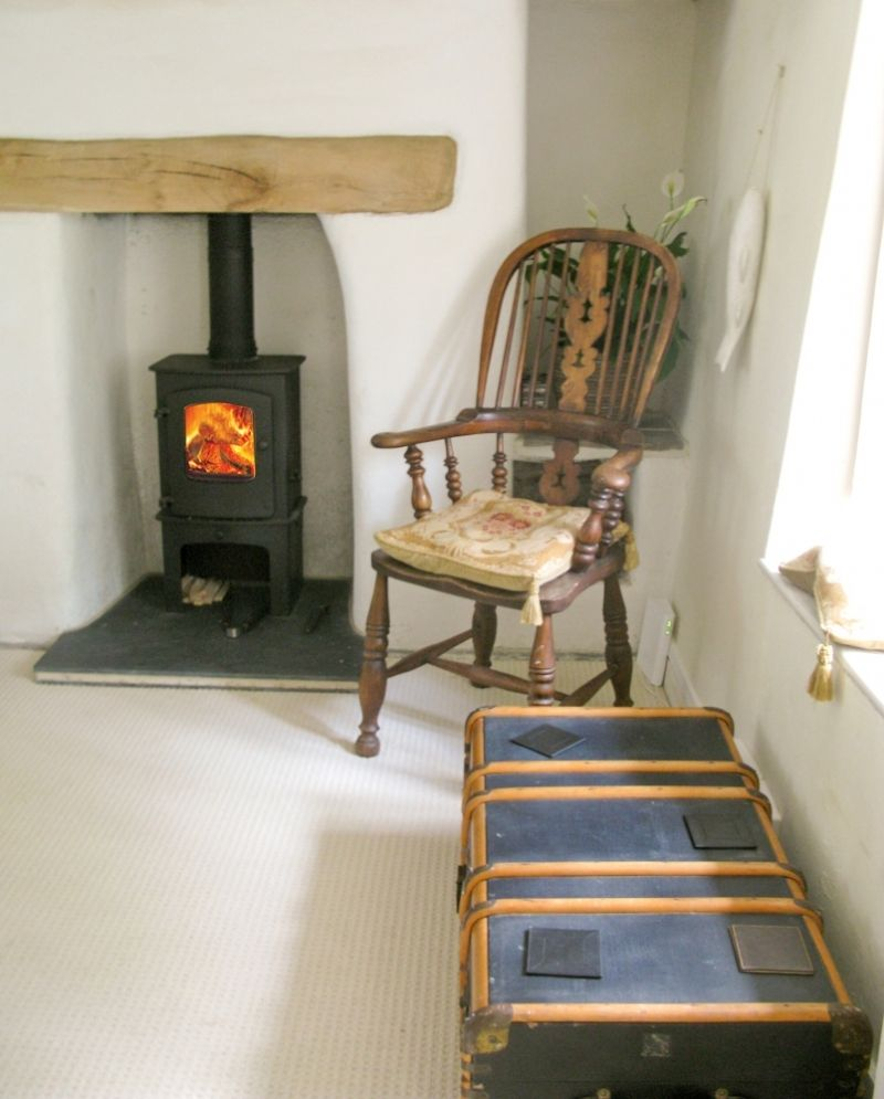 charnwood cove with log store installed into a fireplace with a