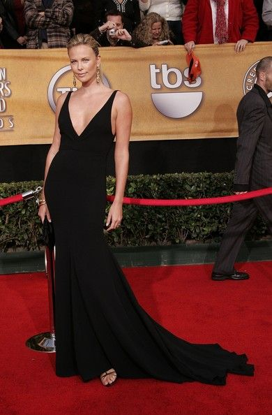 Charlize Theron Evening Dress Charlize epitomized elegance in a floor  sweeping black evening gown at the SAG Awards. 62c5b34c65f