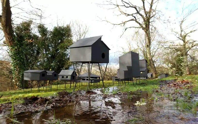 Black palafitos stilt houses in spain by javier requejo