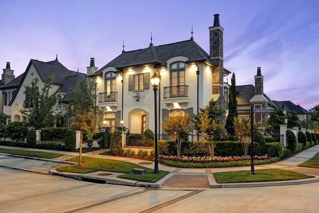 French Provincial Home Exterior With Meticulous Landscaping