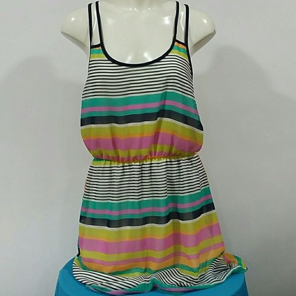 Multi color summer dress Preloved no stains , small snag on the bottom not noticeable,  this dress in lined so it's not see thru, crisscross straps in the back, Charlotte Russe Dresses