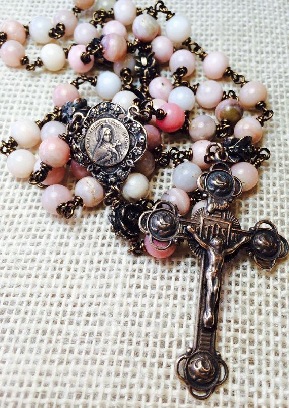 St. Therese of Lisieux Rose Rosary, Wire wrapped, Bronze, Heirloom, Peruvian Pink Opal 8mm, Catholic Jewelry, Christian Jewelry #rosaryjewelry This beautiful heirloom rosary is handcrafted with 8mm peruvian pink opal with a center of St Therese of Lisieux By Et Corde Rosaries & Jewelry #rosaryjewelry