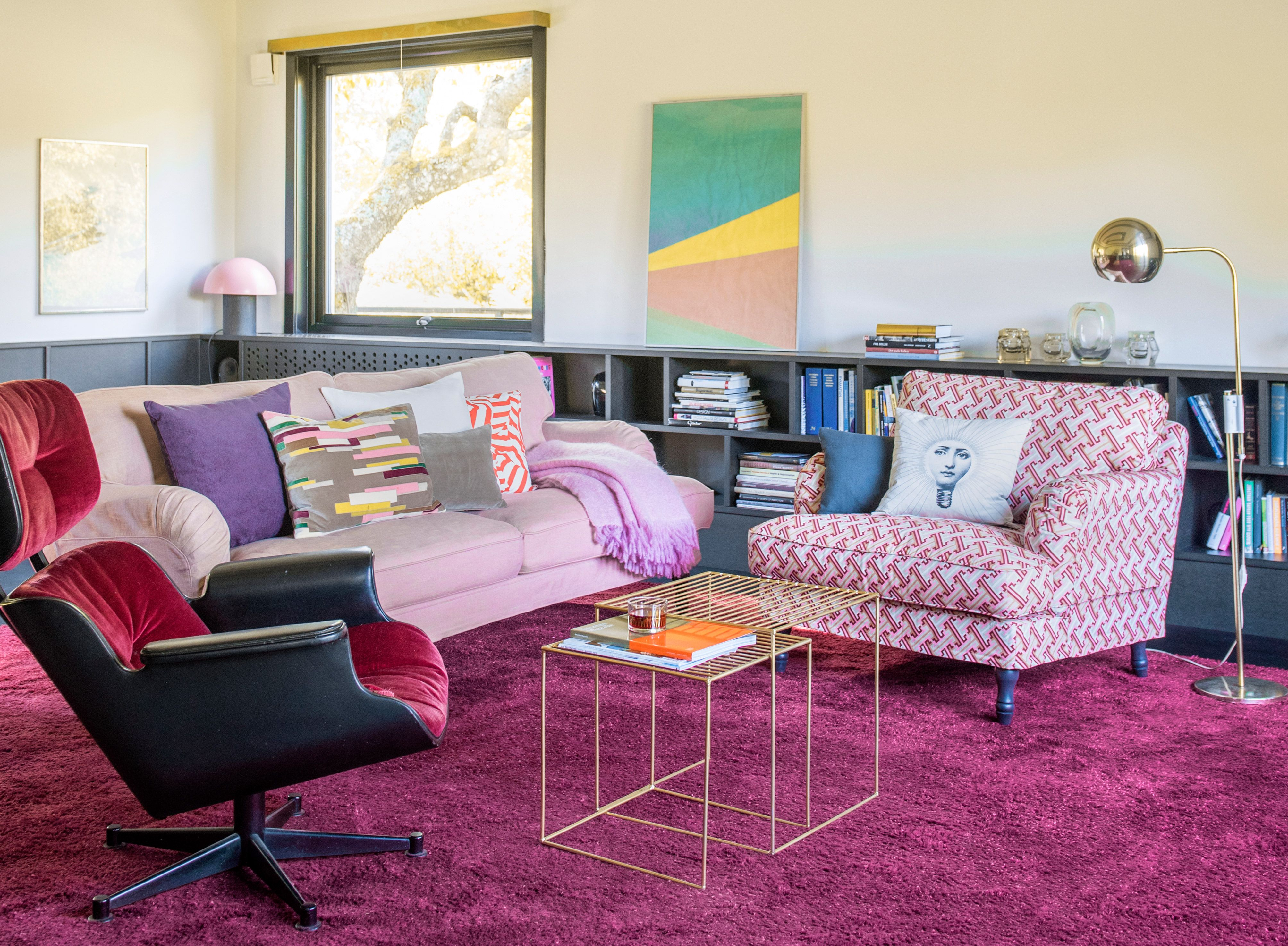 That velvet Eames chair though eclectic pink living room