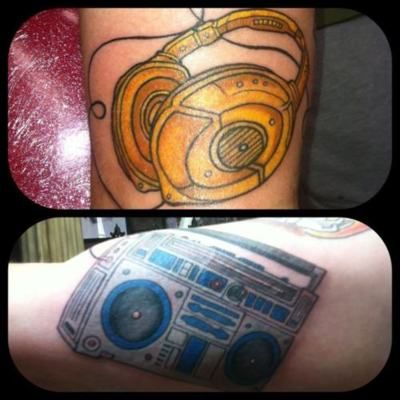 A star wars tattoo I did on my good friend Dizzy. C3p0 headphones and R2d2 ghetto blaster. May the 4th be with you.