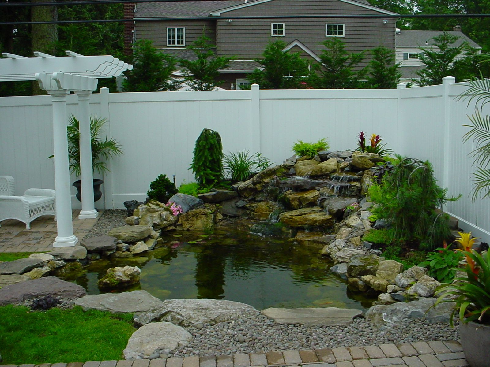 Small backyard ponds and waterfalls call for free for Patio koi pond
