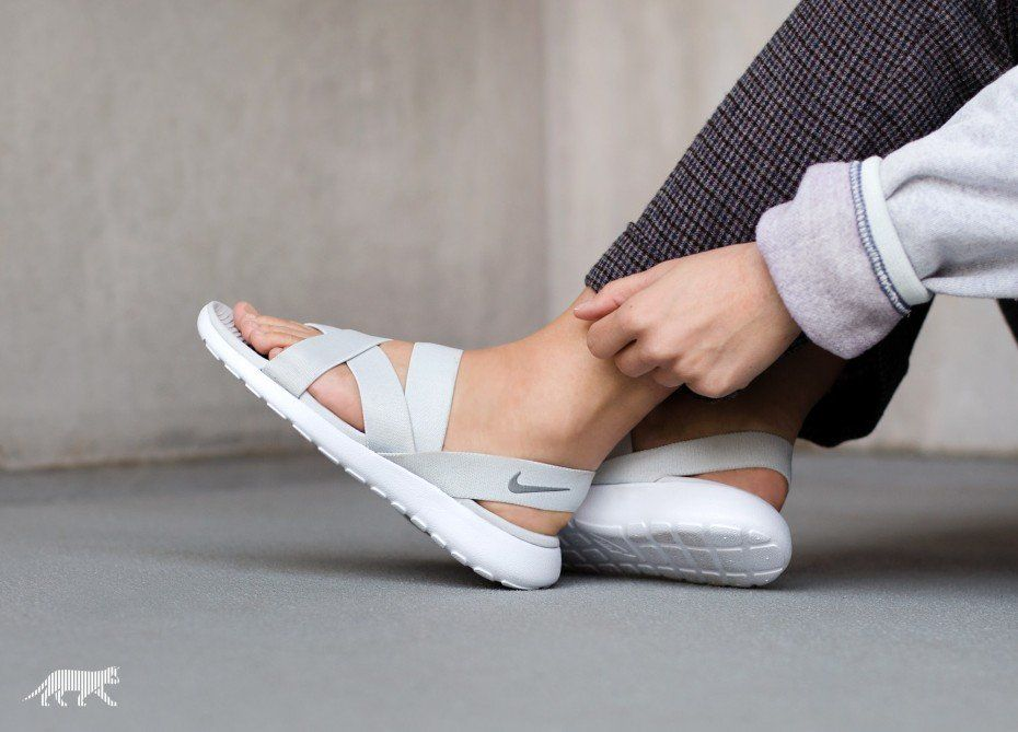 grey and white nike sandals