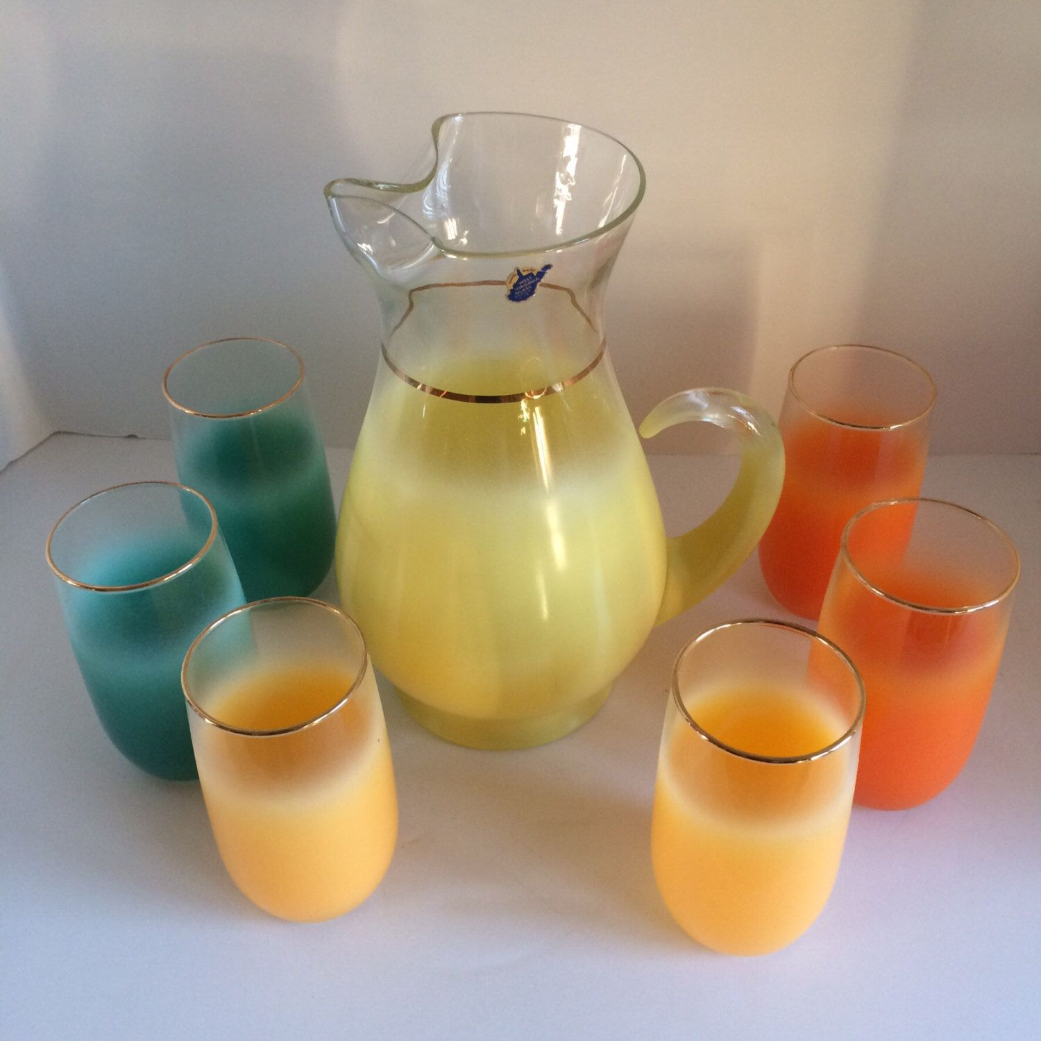 Gorgeous Blendo Pitcher and Six Glasses, Yellow, Orange, Turquoise, Mid Century Bar,  Unused New Condition, Original Manufacturers Sticker by CountryGirlsVintage on Etsy https://www.etsy.com/listing/225600836/gorgeous-blendo-pitcher-and-six-glasses