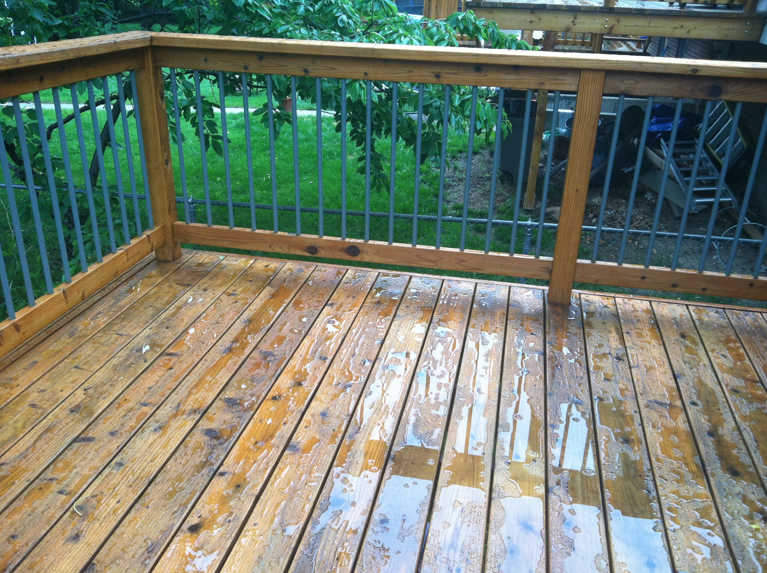 Cabot deck stain in wood toned cedar after a rain storm for Garden decking varnish