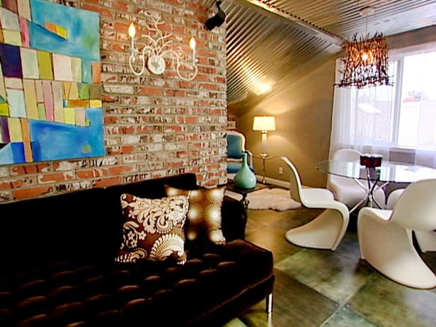 An eclectic mix of rustic brick, modern furnishings and an industrial ceiling provide personality and makes the space fun and relaxing.