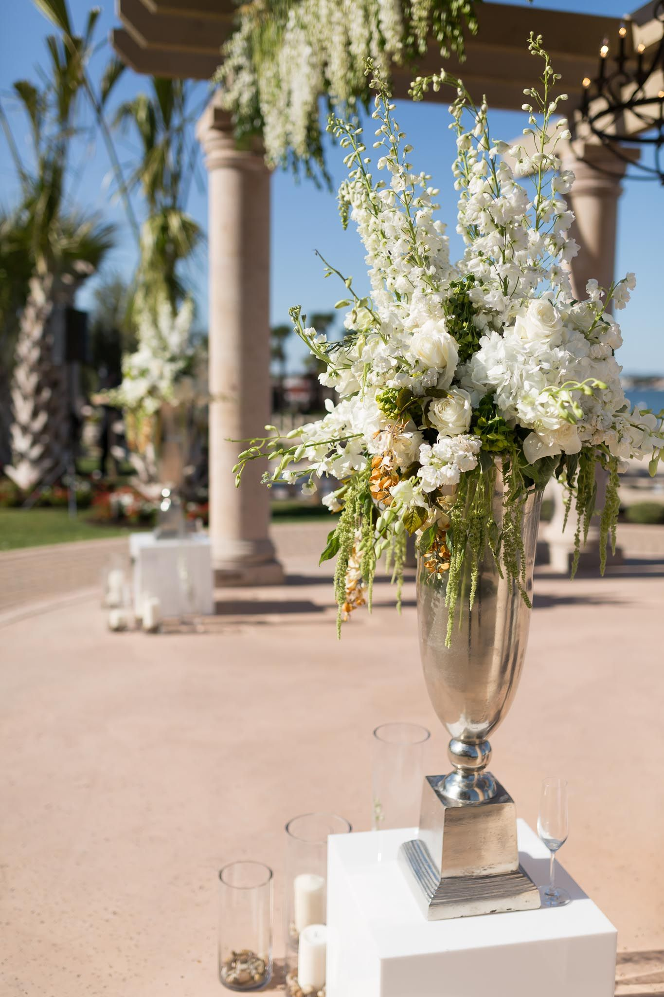 Up Close View Of The White Floral Arrangement Used For Ceremony Space Under The Pergola White Floral Arrangements Floral Arrangements Floral Wedding