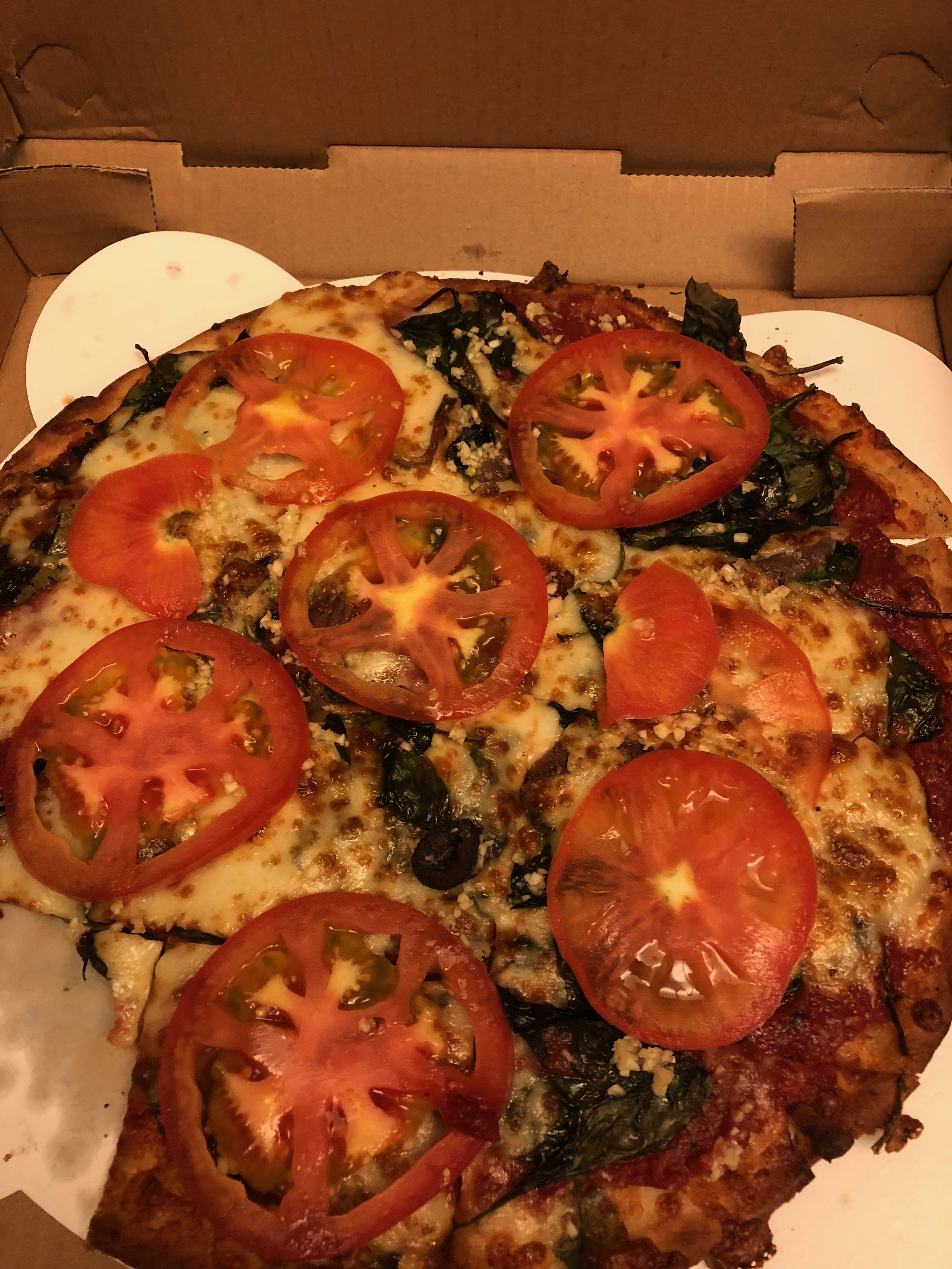 Fresh Brother's gluten free pizza with tomato spinach ...