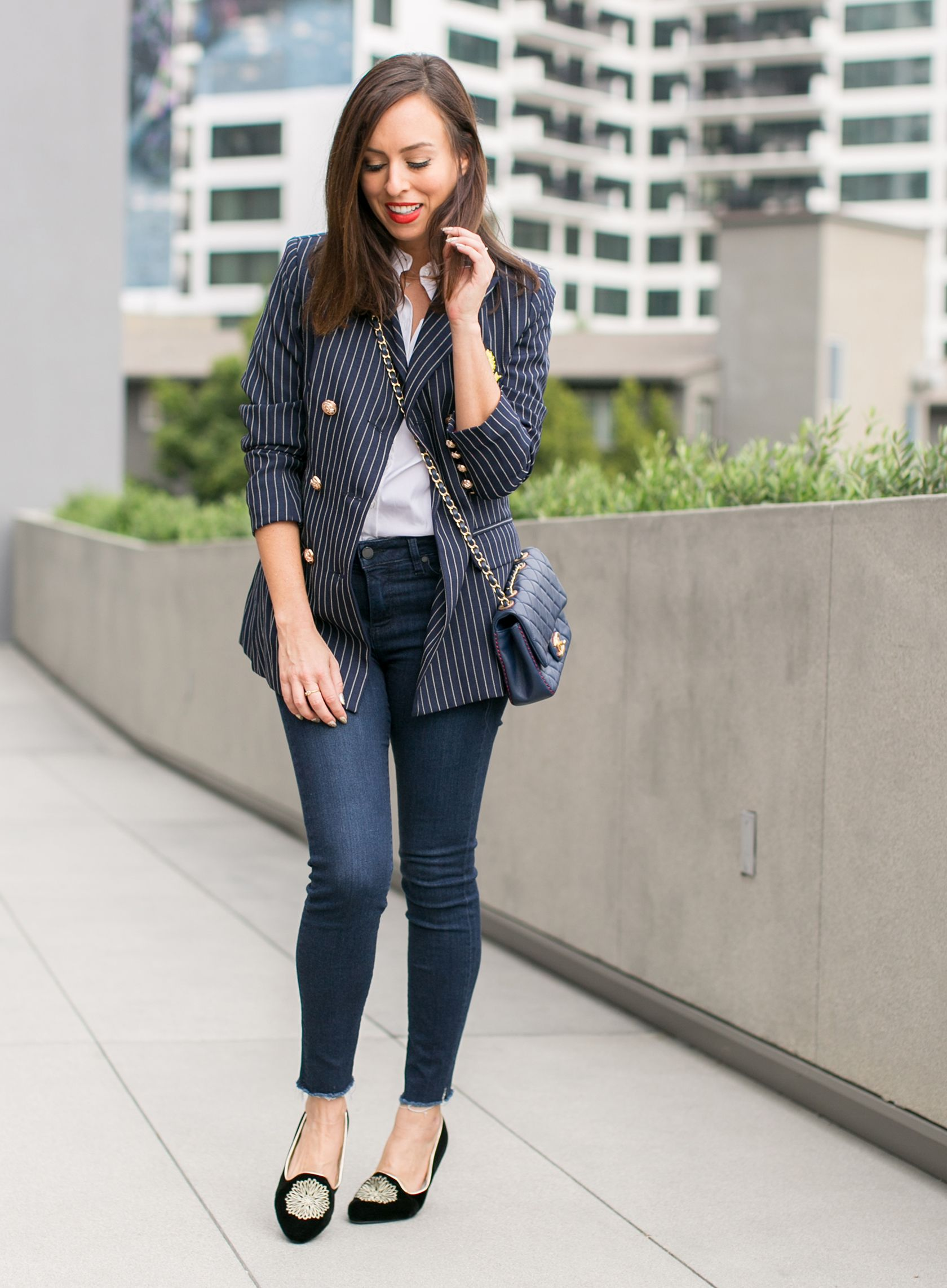 b93d7f1b5c0 Sydne Style shows what to wear to the office for casual friday in jeans and  a pinstripe blazer  blazer  chanel  chanelbag  casualstyle  casualoutfit   jeans ...