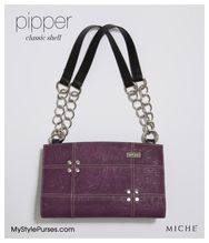 Pipper's lightly-textured faux leather in medium orchid purple will make your heart beat a little faster. When you see this Classic Shell's whimsical contrasting geometric stitching detail and perfectly-placed rivet accents, you'll completely fall in love!