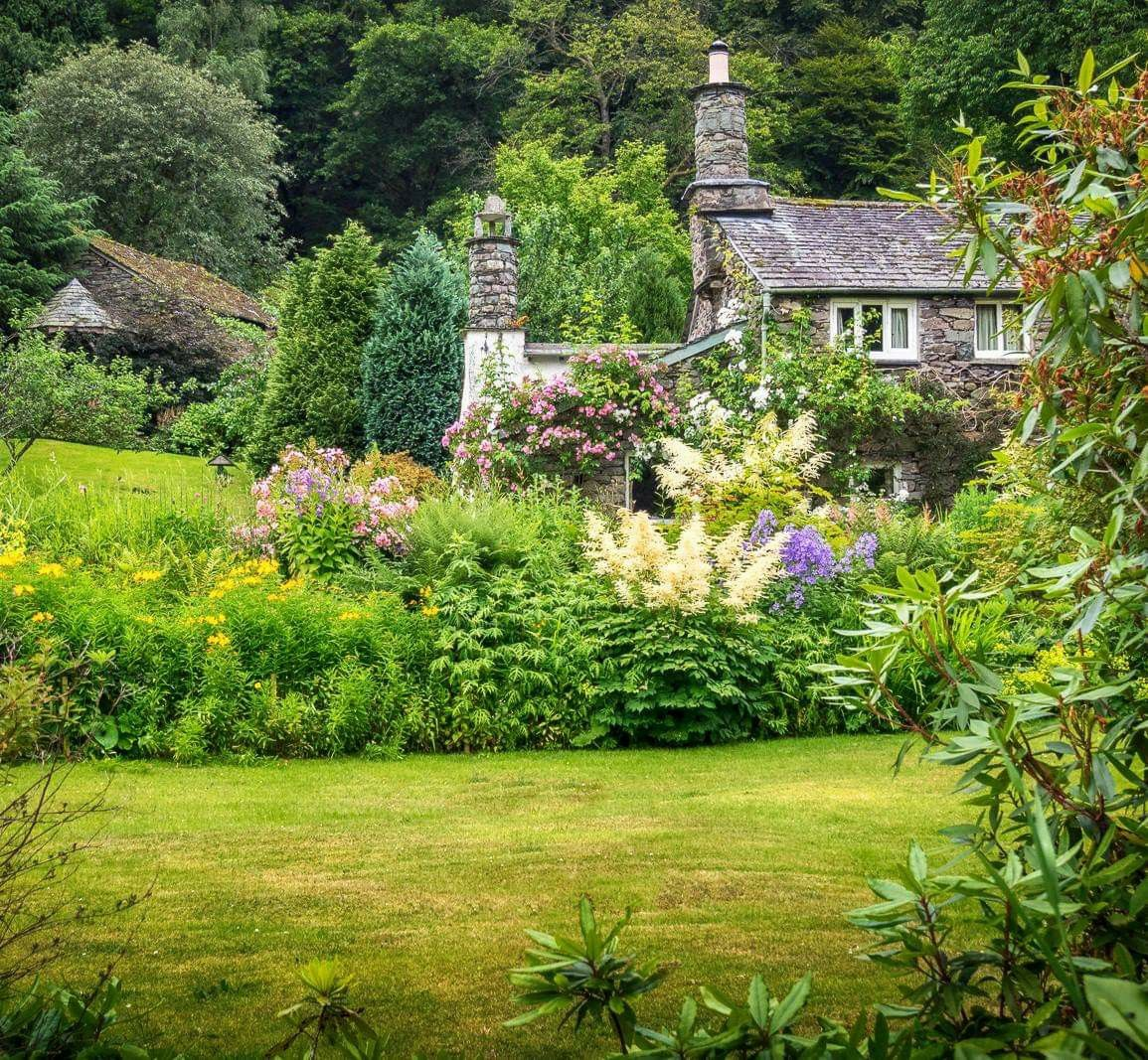 The Beautiful Gardens Of A Stone Cottage At Grasmere In