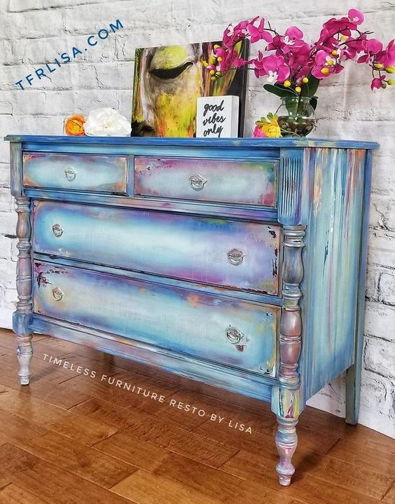 Give your old dresser new life with a rainbow paint tutorial. #diy #diyhomedecor #upcycle